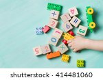 child playing with wooden cubes ...   Shutterstock . vector #414481060