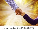 the parent holds the hand of a... | Shutterstock . vector #414490279