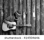 Musician Playing Guitar Leaning ...