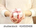 female hands holding beautiful... | Shutterstock . vector #414535408
