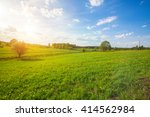 green field with flowers under... | Shutterstock . vector #414562984