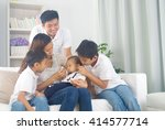 asian family playing with baby | Shutterstock . vector #414577714