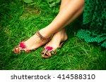 female legs on grass in leather ... | Shutterstock . vector #414588310
