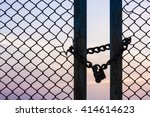 Silhouette Lock On A Chain Link ...