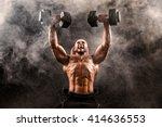 bald topless muscular man doing ... | Shutterstock . vector #414636553