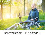 young woman with bike in spring ... | Shutterstock . vector #414659353