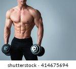 young bodybuilder with... | Shutterstock . vector #414675694