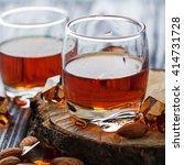 Small photo of Almond liquor amaretto and almonds. Selective focus, square image