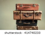Vintage Pile Ancient Suitcases...