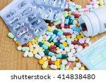 pill bottle spilling pills and... | Shutterstock . vector #414838480
