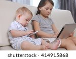 children sit and play a game on ... | Shutterstock . vector #414915868
