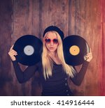 a blonde hipster girl with... | Shutterstock . vector #414916444