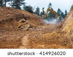 Small photo of Yellow digger working on a road construction in mountain