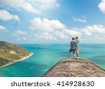 young couple of travelers on a... | Shutterstock . vector #414928630