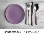 empty plate with silver cutlery ...