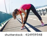 young sportswoman stretching... | Shutterstock . vector #414959548