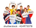 kids holding greeting signs in... | Shutterstock . vector #414973378