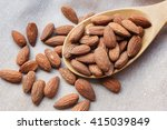 almonds in wooden bowl on table ... | Shutterstock . vector #415039849