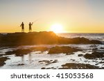 Fishermen Silhouettes At...