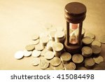 coin money and hourglass for... | Shutterstock . vector #415084498