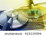 a stethoscope by a credit cards ... | Shutterstock . vector #415119394