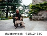 Small photo of ITALY-FIRENZE- 25 october 2015 - Professional Trifulau (truffle hunter) and his dog search for truffles in the tuscanian forrest