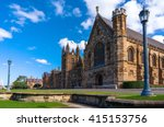 Sydney Uni building facade. University of Sydney against deep blue sky with white clouds, daytime photo