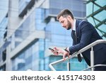 businessman looking at phone in ... | Shutterstock . vector #415174303