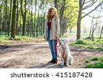 Stock photo girl walking dog in park 415187428