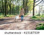Girl Walking Dog In Park