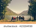 Group Of People Sitting On A...