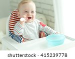 portrait of happy young baby... | Shutterstock . vector #415239778