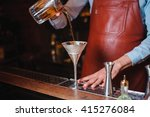 bartender pouring a cocktail... | Shutterstock . vector #415276084