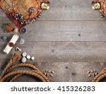 travel items on wooden table.... | Shutterstock . vector #415326283