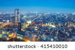 Small photo of Tilt shift Photo High-rising buildings lighting up in tokyo