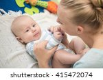 mother with infant boy | Shutterstock . vector #415472074