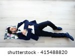 Young Tired Businessman With A...