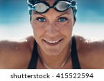 beautiful female swimmer | Shutterstock . vector #415522594