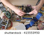 Small photo of Young man repairing computer hardware in service center