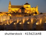 Small photo of Night view of Mezquita-Catedral and Puente Romano - Mosque-Cathedral and the Roman Bridge in Cordoba, Andalusia, Spain
