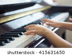 girl practices a piano lesson | Shutterstock . vector #415631650