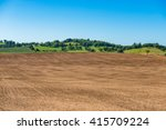 Tilled Farm Field With Green...