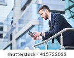 businessman holding a tablet on ... | Shutterstock . vector #415723033