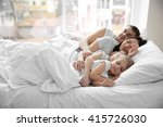 family sleeping in bed  closeup | Shutterstock . vector #415726030