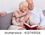 elderly couple in love reading... | Shutterstock . vector #415745026