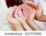baby foot in the hands of... | Shutterstock . vector #415753900