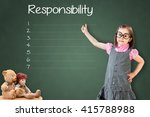Small photo of Cute little girl wearing business dress and showing responsibility list in blank on green chalk board.