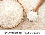 jasmine rice in a wooden spoon... | Shutterstock . vector #415791193