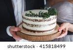 bride and groom hold wedding... | Shutterstock . vector #415818499