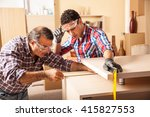 two carpenters working at... | Shutterstock . vector #415827553